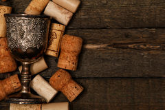 Medieval goblet and wine corks Stock Images