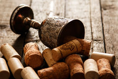 Medieval goblet and wine corks Royalty Free Stock Image