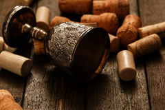 Medieval goblet and wine corks Stock Image