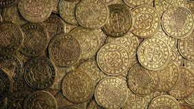 Medieval Gold Coins Pile Rotating Overhead Shot. Closeup of very old gold coins rotating stock video footage
