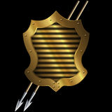 Medieval gold shield with two spears. Royalty Free Stock Photo