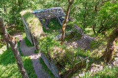 Medieval Gothic castle ruin excavation archeology site in forest Stock Image