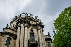 Ancient architecture of the city Lviv. The facade of an ancient Dominican Church and the spring rain the sky. Medieval Gothic Church architecture. The ancient royalty free stock photo