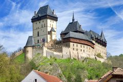 Medieval gothic royal castle with ramparts  Karlstejn near Pragu Stock Images