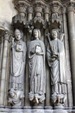 Medieval gothic statues on entry to Eglise St. Germain l`Auxerrois in Paris Royalty Free Stock Photos