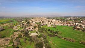 Medieval Gothic Stone Town Aerial Drone View. Pals has a historic centre on a hill surrounded by plains with a medieval Romanesque tower built between the 11th stock video footage