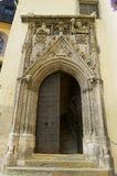 Medieval gothic style building entrance door with stone carved decoration in Regensburg, Germany. REGENSBURG, GERMANY - SEPTEMBER 03, 2010: Medieval gothic Royalty Free Stock Photos