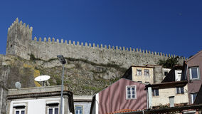Medieval granite wall. Detailed photo of Oporto medieval granite wall with tower and battlements Stock Photography