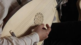 Medieval guitarist. Hand fingers on guitar chords stock video footage