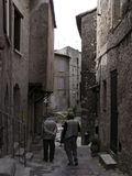 Medieval hamlet of Provence 2. Aged tourists  in a street of  Les Arcs sur Argens, Provence, France -  medieval hamlet Stock Photos