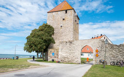 Medieval Hanse town Visby on Gotland. Visby, Sweden - July 8, 2016: The medieval city wall and the gunpowder tower in Visby. Visby is a historic Hanse town and a Royalty Free Stock Image