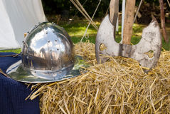 Medieval helmet and axe on hay stock photos