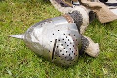 Medieval helmet fallen on the ground Royalty Free Stock Photo
