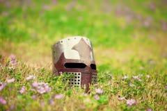 Medieval helmet. On grass at otudroor Royalty Free Stock Photos
