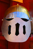 Medieval helmet. Silver colored medieval helmet with a round top with slits Stock Photo