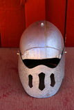Medieval helmet. Silver colored medieval helmet with a round top with slits Royalty Free Stock Photography