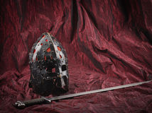 Medieval helmet and sword Stock Photography