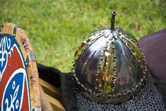 Medieval Helmet and wooden shield Stock Images