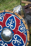 Medieval Helmet and wooden shield Stock Photos