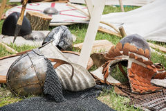 Medieval helmets. On the ground Stock Photography