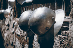 Medieval helmets hanging on a wall, Trentino Alto Adige, Italy. Stock Photography