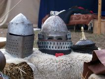 Medieval helmets. Sitting on a sheepskin Stock Photo