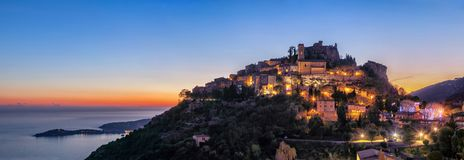 Medieval hilltop village Eze at dusk, France. Panoramic view of medieval hilltop village Eze at dusk,  Alpes-Maritimes, France Royalty Free Stock Photography
