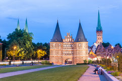Medieval Holstentor gate at night, Lubeck, Germany Stock Images