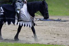 Medieval horse walking Stock Photography