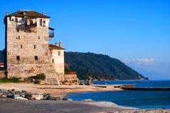 Medieval hotel by the sea 2. Medieval hotel by the sea on a sunny blue sky day . Greece Stock Photography