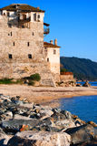Medieval hotel by the sea. On a sunny blue sky day . Greece Stock Photography