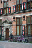 Medieval house with bicycles Stock Photos