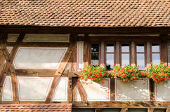 Medieval house with flowers. On balcony Royalty Free Stock Photo