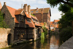 Medieval houses. Ancient houses by a canal in Bruges, Belgium Stock Photos