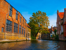 Medieval houses along canals of Bruges in autumn Stock Photos