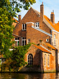 Medieval houses along canals of Bruges in autumn Royalty Free Stock Image