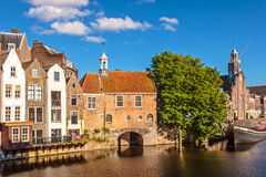 Medieval houses alongside a canal in Delfshaven, The Netherlands. Summer view of medieval houses alongside a canal in Delfshaven, The Netherlands Stock Photos