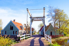 Medieval houses and bridge in the countryside from the Netherlan Stock Image