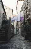 Medieval houses in the narrow streets of Dubrovnik with hanging clothes and stone stairs royalty free stock photo