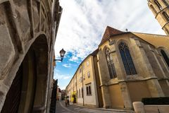 Benetictine church and cloister viewing from under arched gate royalty free stock images