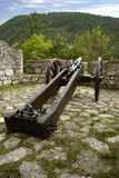 Medieval iron cannon in castle. Medieval european cannon in castle fortification stock photos