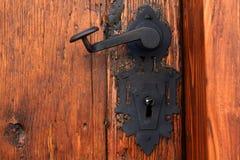 Medieval iron door handle. And lock on wood door in Brasov, Romania Stock Photos