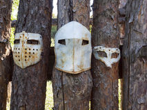 Medieval iron mask hanging on the fence. Stock Photos