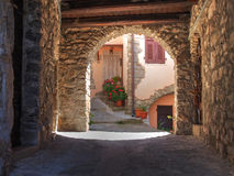 Medieval Italian village with flowers. Stock Photos