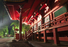 Medieval Japanese temple at dusk. Illuminated wooden entrance to traditional medieval Japanese temple at dusk Stock Images