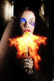 Medieval jester breathing fire during carnival act Royalty Free Stock Image