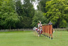 A medieval joust with knights in armour and costume Royalty Free Stock Image