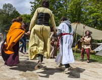 Medieval Joy. Nogent le Rotrou,France, 12.05.2013: Group of medieval people dancing in front of traditional tents during the Percheval Medieval Festival, near Stock Images