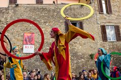 Medieval juggler on italian street. Juggler on the street dressed in medieval theme performs during a party in an Italian country. Tuscany Italy Stock Image