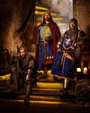 Medieval king with his  knights in ancient  castle interior. Royalty Free Stock Photos